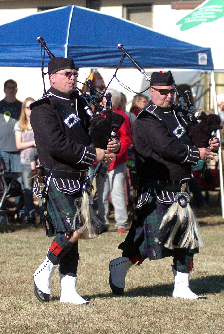 "A pair of bagpipers walk toward the stage during a ceremony at the fifth annual Veterans Day Parade at Chaffee Crossing was held on Saturday, November 12, 2016 at the Chaffee Crossing Historic District in Fort Smith. The parade's theme was ""Women In The Military,"" and was held to honor veterans from all branches of service and all U.S. wars. (Please include credit when using this photo) STEVE MARQUEZ/StMarq Photography"