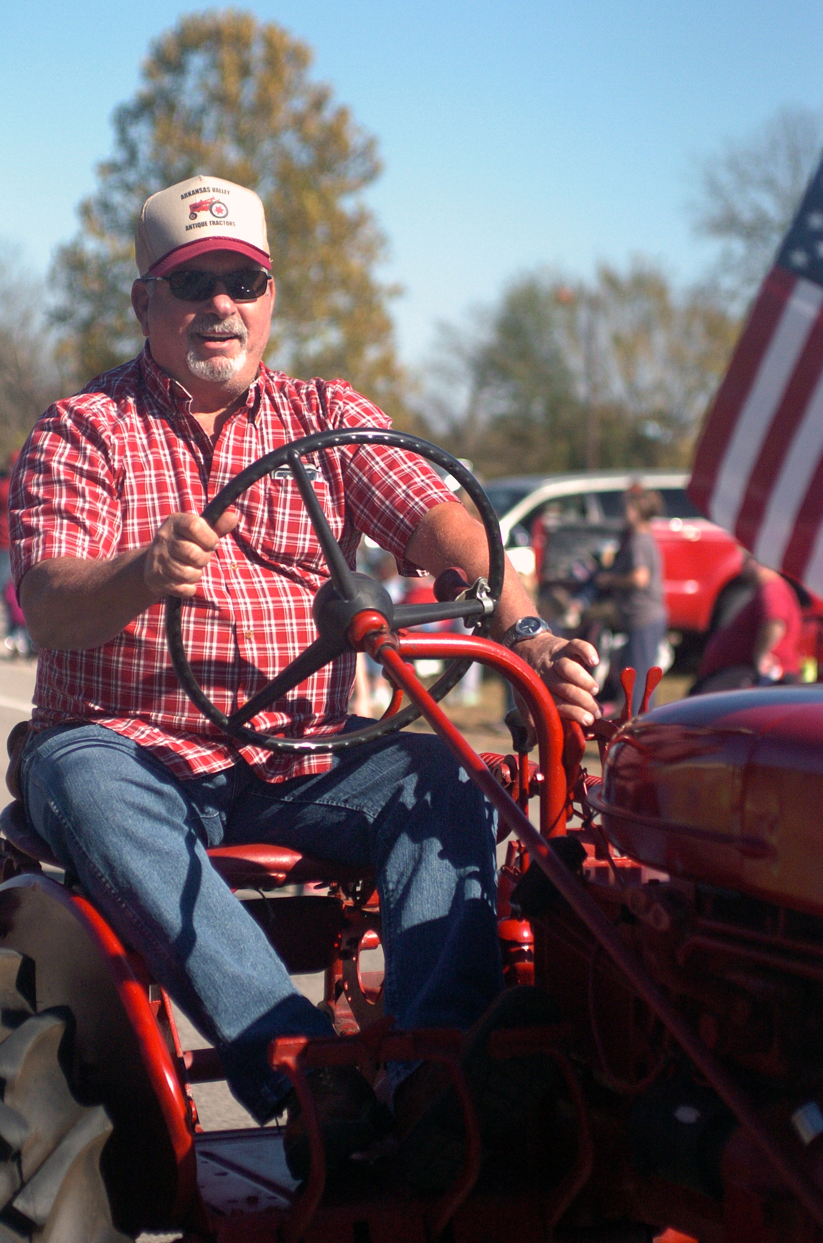 "A tractor driver stares intently as he drives down the road at the fifth annual Veterans Day Parade at Chaffee Crossing was held on Saturday, November 12, 2016 at the Chaffee Crossing Historic District in Fort Smith. The parade's theme was ""Women In The Military,"" and was held to honor veterans from all branches of service and all U.S. wars. (Please include credit when using this photo) STEVE MARQUEZ/StMarq Photography"