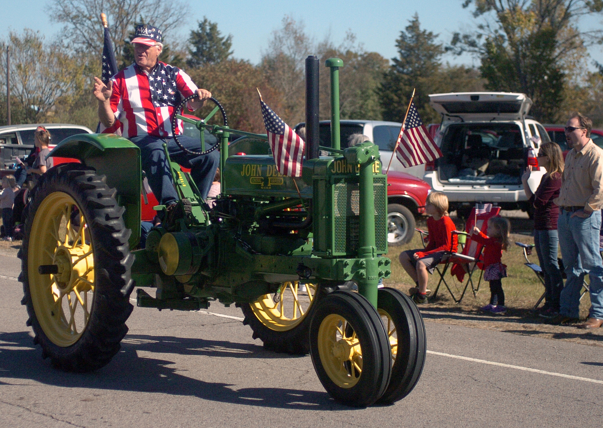 "A tractor driver points to the crowd at the fifth annual Veterans Day Parade at Chaffee Crossing was held on Saturday, November 12, 2016 at the Chaffee Crossing Historic District in Fort Smith. The parade's theme was ""Women In The Military,"" and was held to honor veterans from all branches of service and all U.S. wars. (Please include credit when using this photo) STEVE MARQUEZ/StMarq Photography"