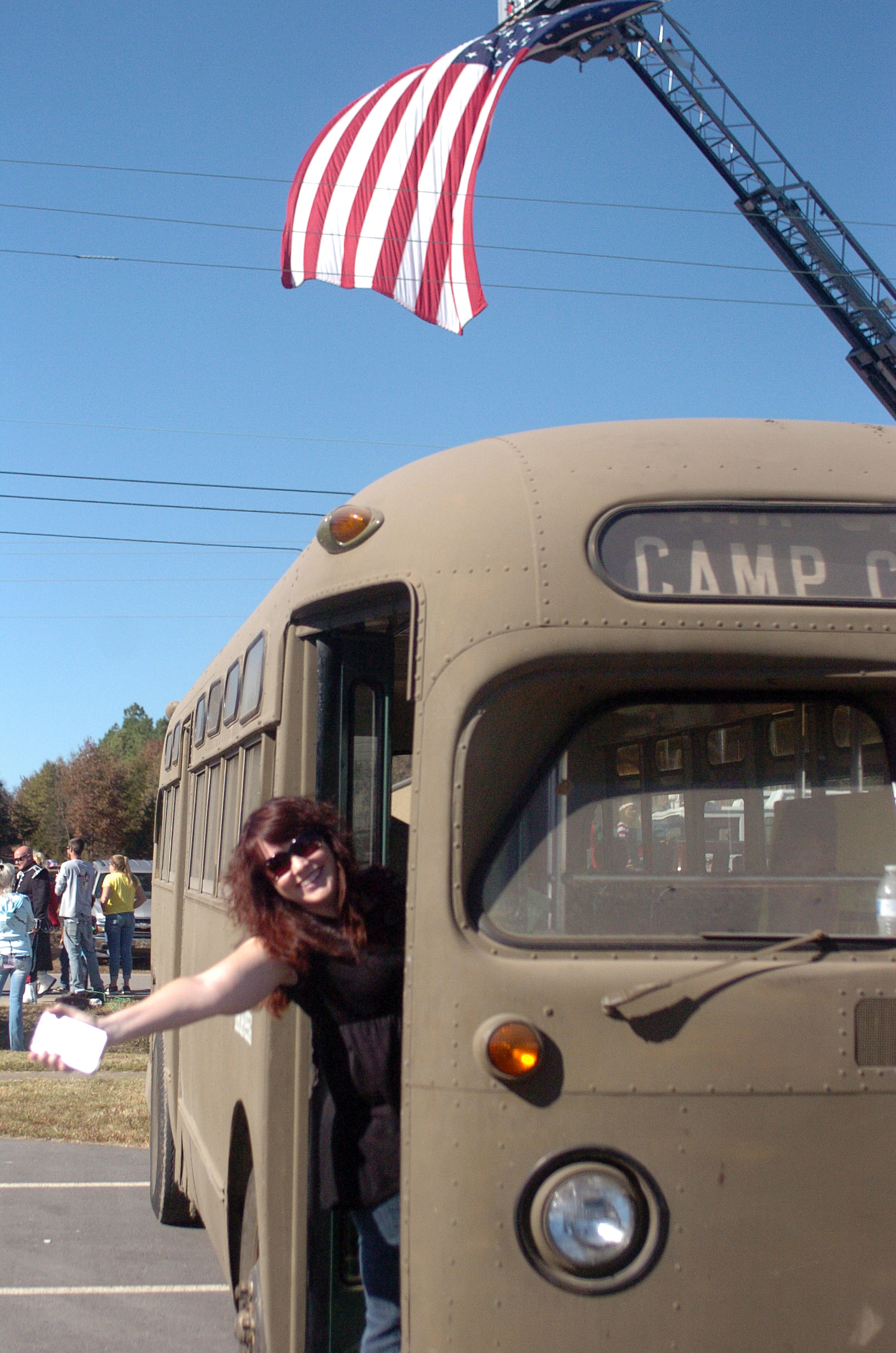 "Monica Marquez stands in a bus at the fifth annual Veterans Day Parade at Chaffee Crossing was held on Saturday, November 12, 2016 at the Chaffee Crossing Historic District in Fort Smith. The parade's theme was ""Women In The Military,"" and was held to honor veterans from all branches of service and all U.S. wars. (Please include credit when using this photo) STEVE MARQUEZ/StMarq Photography"
