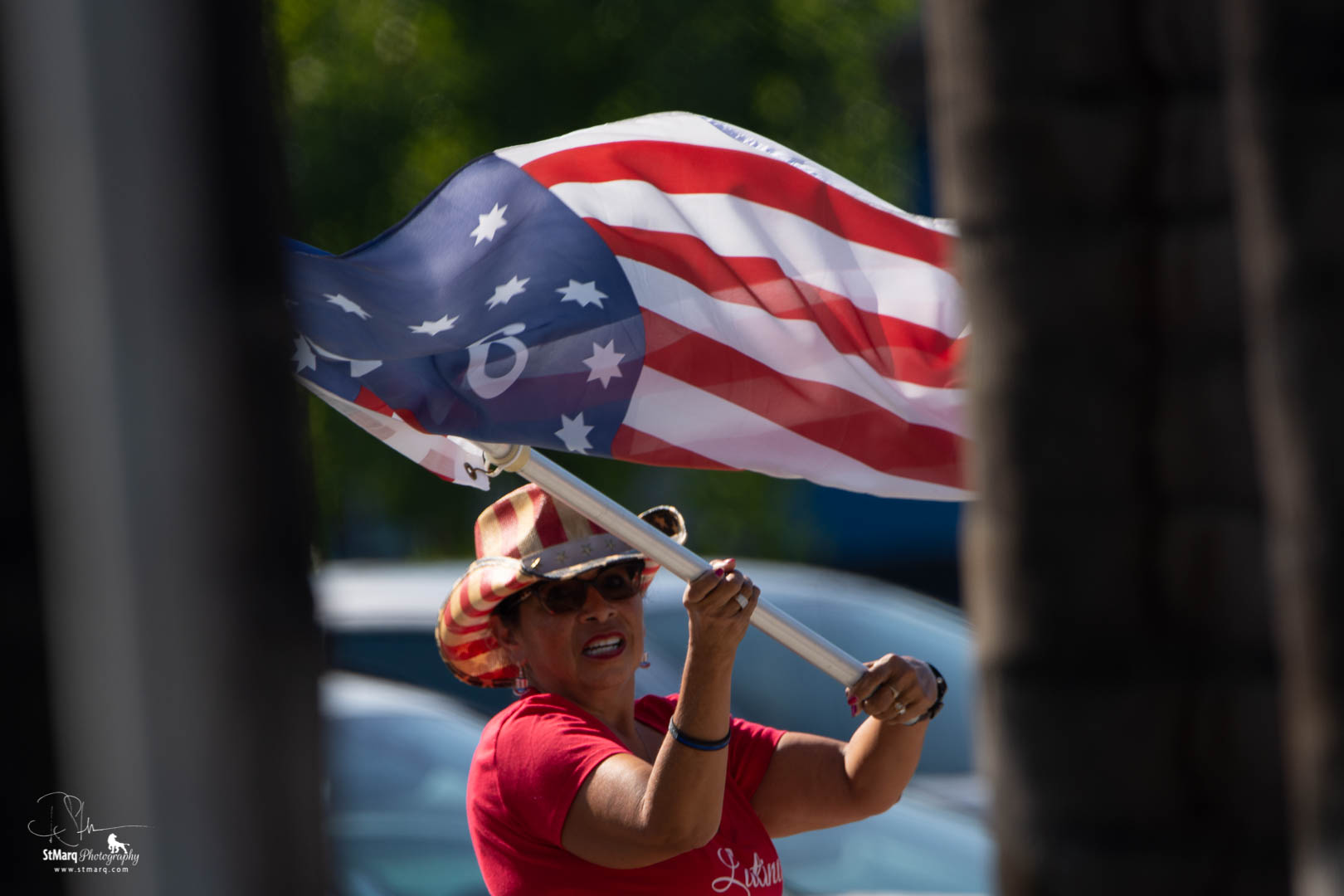 Marilyn Castillo waves the American flag at a Rally in support of President Trump.