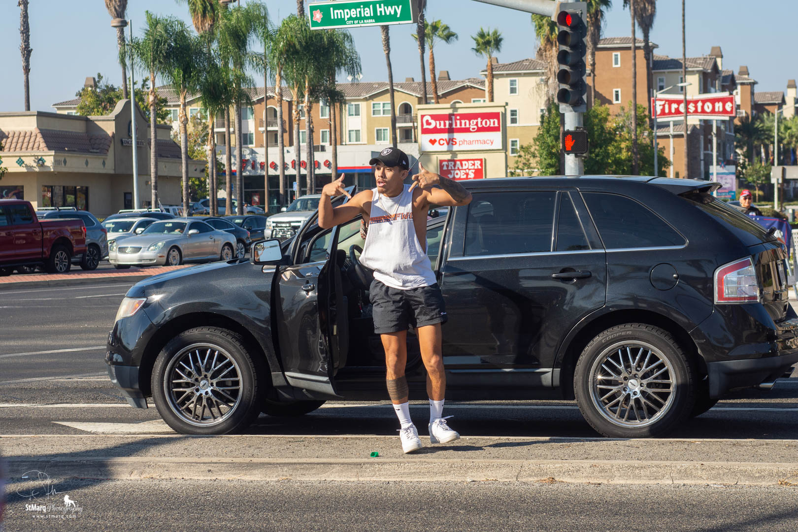 A counter Trump Rally protester danced outside his car with obscene hand gestures as he was waiting to make a left turn from Imperial Highway in front of Trump supporters.