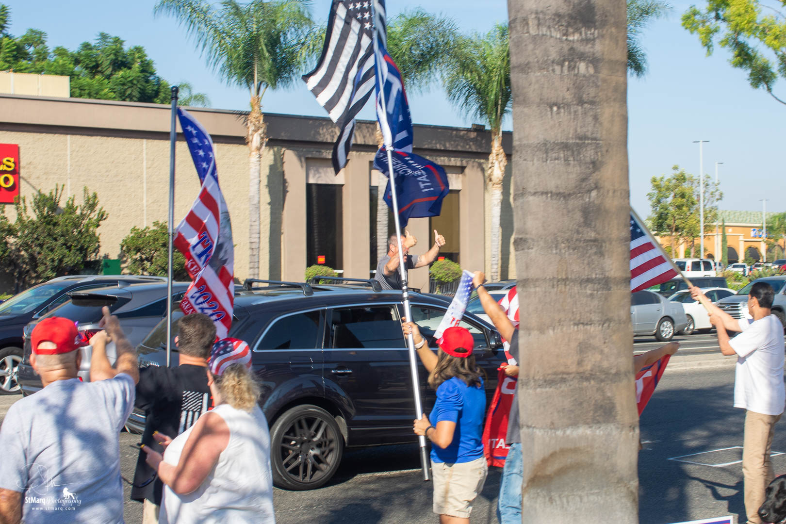 Backers of president Trump hold flags to show their support on the corner of Beach Blvd. and Imperial Highway in La Habra, CA on Sunday, October 18, 2020. They were attempting to show that California has supporters of the president even though it is usually written off as a Democrat stronghold.