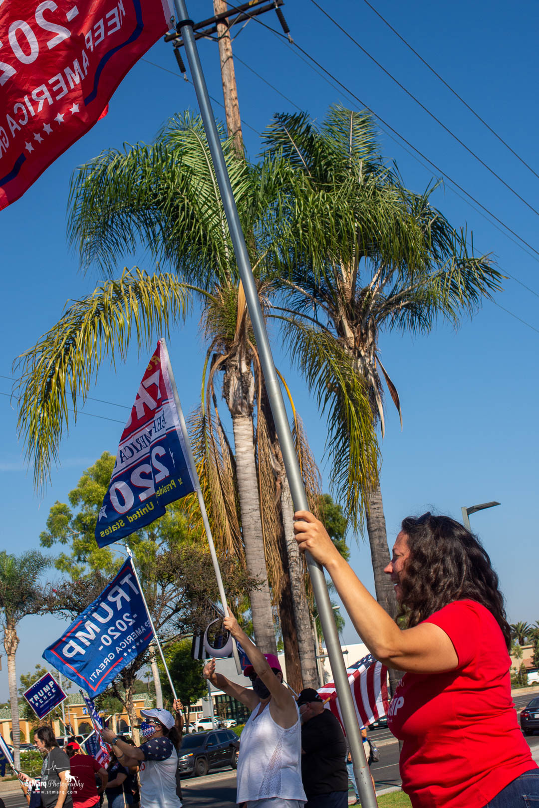 Caroline Hesse holds a pole with a Trump 2020 flag in support of the president at a Rally she and her boyfriend, Steven co-organized on Sunday, October 18, 2020 in La Habra, California.