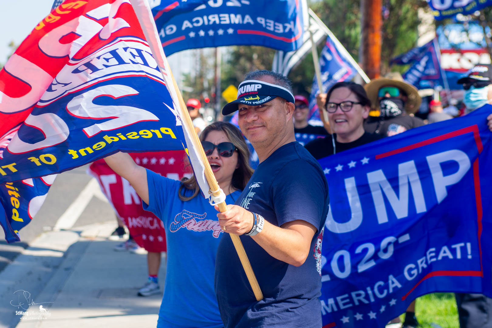 Bill Thomas, center, holding flag, and his wife, center, left, attend a Rally in support of President Trump on Sunday, October 18, 2020 in La Habra, CA.